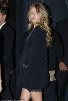 Keeping warm: Gigi covered up in a chic tuxedo jacket...