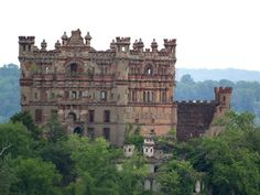 Bannerman Castle - Bannerman Island, New York - Scottish immigrant Francis Bannerman purchased the island in 1900 and built the castle to advertise his military surplus business. Two years after his death in 1918, 200 tons of ammunition stored there exploded, destroying part of the structure. Fire destroyed much of the interior / structure in 1969...
