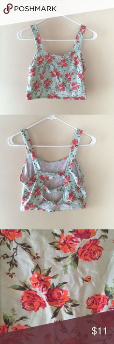 Flower crop top NWOT. True to size. No trades ✅ Price Negotiable  ✅ Bundles ▪️smoke free/pet free home  Same/Next day shipping   Instagram: @laurenweichmann Pinterest: SantoriniGirl13 Charlotte Russe Tops Crop Tops