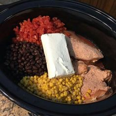 4 chicken breasts, 1 can black beans, 1 can of corn, 1 can rotel, 1 Fiesta Ranch seasoning, 1 block cream cheese. Cook on high 4-6 hrs in crock. Serve on rice or with tortillas.