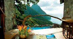 Marvel at the intense blue Caribbean Sea dash against the volcanic Piton Mountains at the plush Ladera Resort, one of the most stunning St Lucia resorts. St Lucia Resorts, Hotels And Resorts, Inclusive Resorts, St Lucia Honeymoon, Honeymoon Spots, Vacation Spots, Vacation Ideas, Vacation List, Honeymoon Ideas