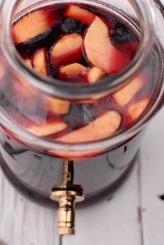 Summer Fruit Sangria:  1 cup pitted mixed cherries 1 cup sliced halved red seedless grapes ½ cup black raspberries 6 sliced/wedged red plums 2 peaches peeled and thinly wedged 2-750 ml bottles or 1-150ml bottle of dry red wine (like Rioja) 1 cup Citronage 2/3 cups brandy Juice of 3 oranges (freshly squeezed or Orange Juice) Ginger ale