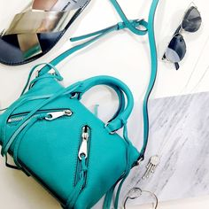 """Rebecca Minkoff Teal Micro Moto Bag Details: • 8"""" W X 6"""" H X 4"""" D • Blue-green leather  • Silver hardware • Top zip closure • Two outer zip pockets • Interior zip pocket and slip pocket • 3"""" handle drop • Adjustable crossbody strap (23-26"""" drop) • NWT and dust bag  04121610 Rebecca Minkoff Bags Mini Bags"""