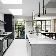 Marble Kitchen Island in Monochrome Kitchen. Kitchen Island Ideas & Designs. Stylish Ideas for Kitchen Islands from seating and lighting to free standing Kitchen Islands and designs for small spaces.