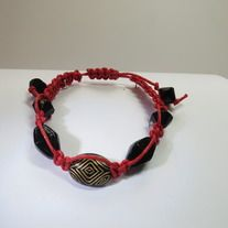 This shamballa bracelet creates a bold look with its black, multi faceted beads and red thread. This statement piece will make all your friends jealous. http://deadwithtequila.storenvy.com/collections/738816-shamballa-bracelets/products/10405764-0118b-shamballa-bracelet