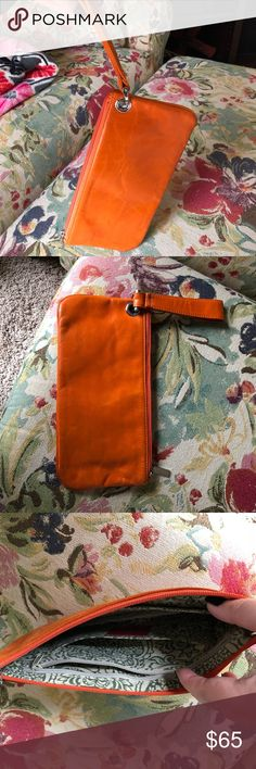HOBO Vida Wristlet in Persimmon This is a HOBO Vida Wristlet in Persimmon (orange). Its big enough to hold a normal size wallet, an iphone plus, and a few other items. Super cute, especially for quick trips or gamedays! HOBO Bags Clutches & Wristlets