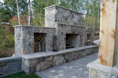 Large custom brick fireplace on edge of backyard patio