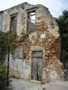 Fabulous crumbling old building on a street corner in Chania, Crete.