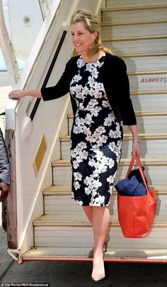 The Countess sensibly rolled up her jacket and put it in her handbag as she arrived into 25 degree heat