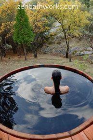 Large 6' round cedar hot tub recessed into deck