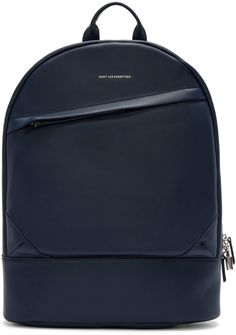 Leather backpack in navy. Carry handle at top. Padded shoulder straps. Two-way zip closure with functional padlock. Diagonal zip pocket and gold logo stamp at face. Fully lined. Padded laptop compartment, zip pocket, and patch pockets at interior. Tonal stitching. Approx. 13