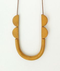 Mustard yellow tube necklace minimal & fun by debroervandevogel