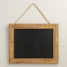 Cost Plus World Market Vintage Style Ruler Chalkboard - Bordered by distressed wooden rulers with a natural jute hanger, our rustic chalkboard looks like something you'd find in a small town antique shop.