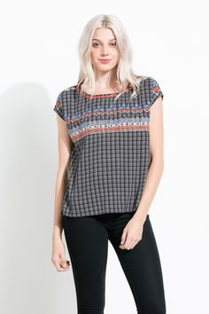 The colorful embroidery paired with the grid print is a great detail on this top!