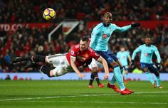 Phil Jones of Manchester United and Benik Afobe of AFC Bournemouth during the Premier League match between Manchester United and AFC Bournemouth at...