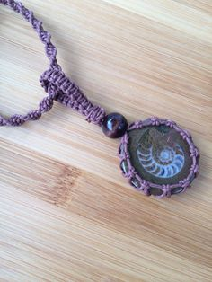 Organic Hemp Wrapped Ammonite Fossil Pendant  by TheSunLab on Etsy, $16.00