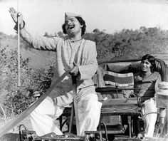Asrani and Amitabh Bachchan in a still from the movie Alaap India First, Amitabh Bachchan, Young Man, Bollywood, Actors, Popular, Couple Photos, Film, Movies