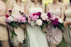 love the mix-matched light pink bridesmaids dresses and abundance of flowers