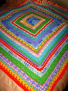 This afghan is done in a bright color palette that invokes the thoughts of Faeries flitting about the woods. Bits of sparkle keep it bright and ethereal. You can use the colors chosen by me, OR you can use scraps to make this a one of a kind creation.