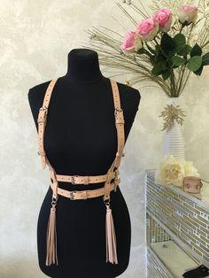 Cute tassel belt to where over a white shirt.