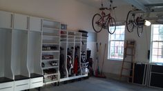 Garage storage with custom made golf bag racks, bicycle storage, and individual boot benches!