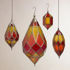 Handcrafted in India, our Warm Multicolor Sabita Embossed Glass Hanging Lanterns make an exceptional statement piece for any space. When a lit tealight candle is placed inside, the lanterns emanate a warm glow of red, orange and yellow. A striking piece on their own, these lanterns also look great grouped together.