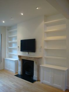 Could do similar without a fireplace using low shelf or storage console to rest tv on.