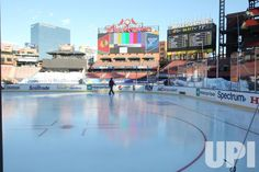 A worker walks across the new ice rink installed inside Busch Stadium in St. Louis on December 29, 2016. The St. Louis Blues will host the…