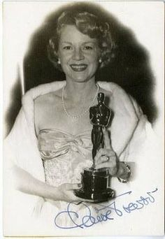 """Claire Trevor with her Oscar for Best Supporting Actress in """"Key Largo"""" (1948)"""