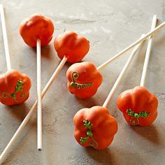 Pumpkin Cake Pops from Sweet Lauren Cakes. The curly piped green vine adds just the right amount of whimsy.