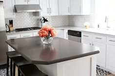 This type of dark grout in white subway tile for a backsplash will be where your eye is drawn. It can be texturally demanding.