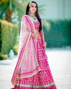 The lehenga offers a fresh and young perspective to Indian bride were with a colour palette so pleasing and soothing. To get this lehenga… Pink Bridal Lehenga, Designer Bridal Lehenga, Pink Lehenga, Indian Bridal Lehenga, Indian Bridal Outfits, Indian Dresses, Bridal Dresses, Wedding Lehanga, Mehendi Outfits