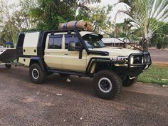 This sandy taupe cruiser with all the goodies. Well thought out barwork and canopy Toyota Cruiser, Fj Cruiser, Landcruiser Ute, Ute Canopy, Land Cruiser 70 Series, Future Trucks, Expedition Truck, Car Camper, Bug Out Vehicle