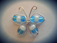 tiny blue and white wire butterfly