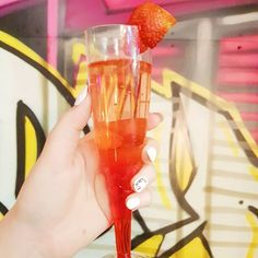 I had some lovely strawberry prosecco from @prosecco_1754 in Trinity Kitchen on Friday!  Isn't it pretty?  The guy who runs the van was lovely too.  Do you like prosecco? . @trinityleeds . [Image description: hand holding a flute glass of pinky-red prosecco with a strawberry on the rim. Background of graffiti/street art]. . . . . . . #prosecco #prosecco1754 #proseccovan #bubbles #trinitykitchen #trinityleeds #leeds #loveleeds #leedsfood #leedsdrinks #leedsbloggers #leedsblogger #Yorkshire…
