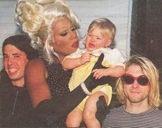 Rupaul holding Kurt Cobain's daughter with Dave Grohl: | 48 Pictures That Perfectly Capture The '90s