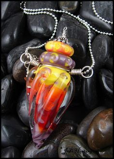 """Fire Lotus"" glass lampwork perfume bottle pendant I made. Available on my website www.beadworx.com"