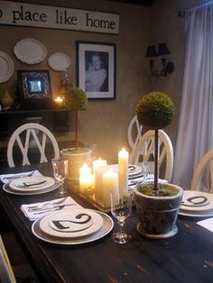 Make your own artwork. RMSer mysweetsavannah handpaints the sign above the buffet and frames black-and-white photos to create this family-friendly dining room.