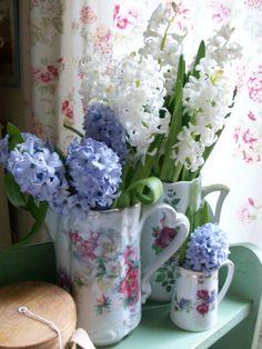 Spring flowers in vintage jugs from Lavender House Vintage.