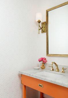 orange vanity paired with brass Hallie Henley Design