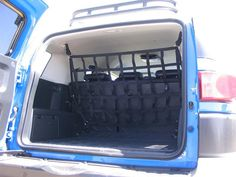 Full ceiling to floor barrier and divider for the Toyota FJ Cruiser to keep gear and a safer option than steel panels for the dogs. Includes our quick release MILSPEC cam buckles mounts for easy remov