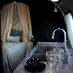 Airstream - kitchens - black, walls, black, kitchen cabinets, glamping,  Glamping! Trailer/camper with black walls and black kitchen cabinet...