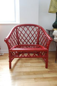 Rattan chair painted red by kimhas7cats, via Flickr I want one of these for our family room