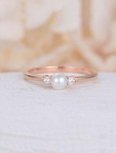 Pearl engagement ring rose gold Diamond wedding women Dainty Three stone Bridal Jewelry Unique Antique Birthstone Promise Anniversary gift Description: - Vintage style Pearl and diamond ring - Natural Conflict free diamonds. - comfortable band Pearl size: aprrox 4.3mm Natural diamond