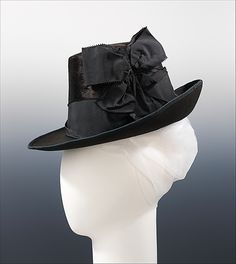 Hat | Mme. Mantel (French) | Date: ca. 1885 | Materials: fur, wool, silk | The style of this hat is based on men's headwear. The crown shape was popular in the 1880s. The hat matches well with the English tailor-made suit, a form that gained popularity at this time because it accommodated an increasingly active lifestyle | The Metropolitan Museum of Art, New York