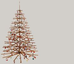 foldable suspended wooden christmas tree - so pretty but I'm not sure it's really that much of a space-saver
