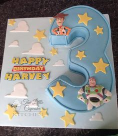 Buzz Lightyear and Woody Toystory  carved number 3 cake.