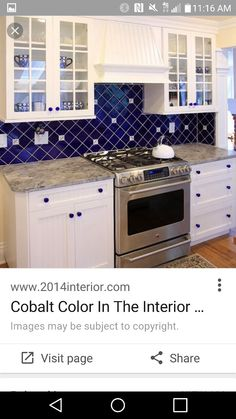 Cobalt blue backsplash with white cabinets, hard wood floor, and stainless appliances.