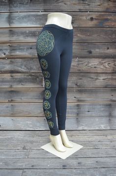 Chakra Leggings - Womens Sacred Geometry Clothing  These comfortable and stylish black american apparel leggings feature a metallic gold and glow in the dark sacred geometric chakra design. The outside of the right leg is decorated with a double layer screen print of my hand drawn seed of life mandala printed in glow in the dark ink with a gold thinned lined seed of life image over it. Under this design is a similar double layer screen print of the chakras, with all of the mandalas printed…