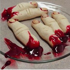 """Halloween: Roll sugar cookie dough in shapes of fingers, make marks for knuckles and make indentation for fingernail. Bake as directed for cookie dough. """"glue"""" almond slices with cherry/strawberry pie sauce for fingernails. Garnish with pie filling for """"gore"""""""